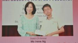 Benjamin Lim receiving his Edusave Award from MP Irene Ng
