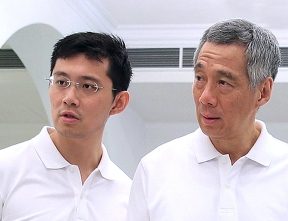Prime Minister Lee Hsien Loong with his son Li Hongyi. Hongyi is now deputy director of the Government Digital Services Data Science Division of the Goverment Technology Agency of Singapore, a statutory board under the Prime Minister's office.